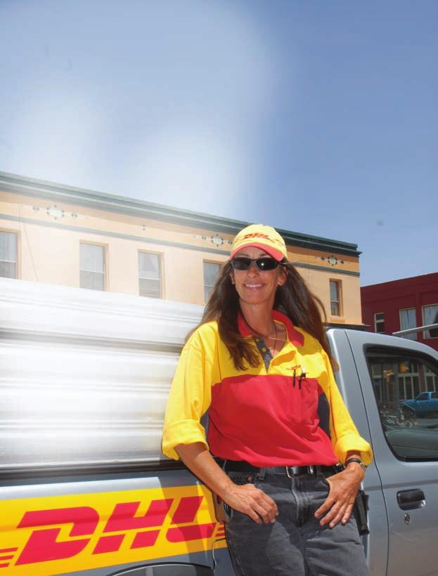 Michelle Geels DHL International WRITTEN AND PHOTOGRAPHED BY JOE BURGESS Okay, so tell me again why this petite Australian-born lady with a college degree is delivering freight for DHL International?
