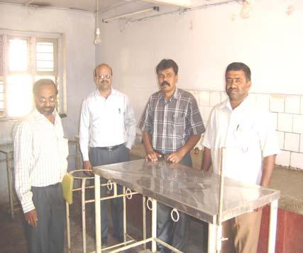 Photo 3: Dr S Yathiraj (first from left), Professor of Veterinary Medicine along with Karuna staff at