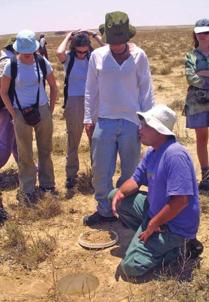 Dror Hawlena (sitting) explains pitfall-trap operation to students of Ben Gurion University of the Negev, Western Negev desert, Israel, 1999. multi-dimensionality of zoology and hence of herpetology.