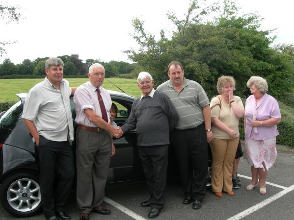The Adams Bothers clan receiving the keys to their car from the MNFC Chairman Tony Whitehurst On now to the race winners Adams Brothers of Stoke on Trent who timed a yearling widowhood cock now named