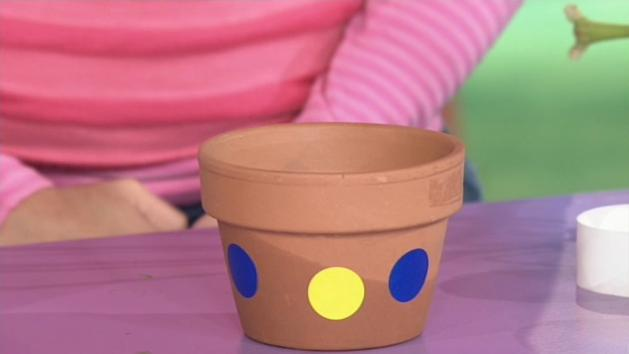 Decorate pot using stickers and/or ribbons.